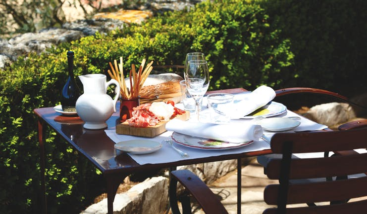 La Bastide de Moustiers Provence outdoor terrace table with bread and charcuterie