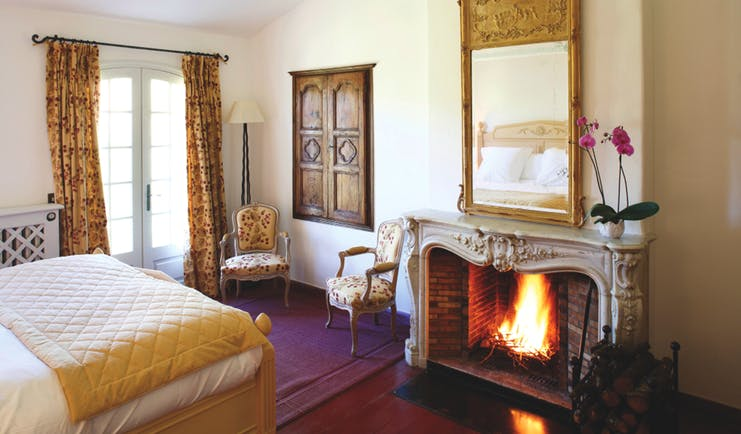 La Bastide de Moustiers Provence aviary bedroom chairs mirror above a fireplace