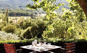 La Bastide de Moustiers Provence terrace dining area overlooking wooded area