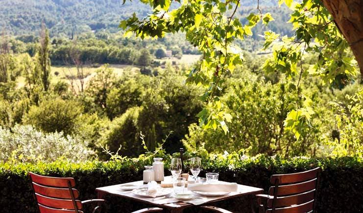 La Bastide de Moustiers Provence terrace dining area overlooking wooded area