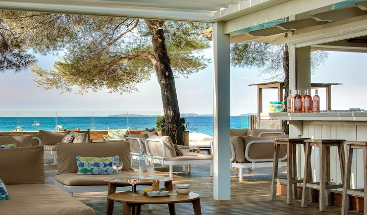 Bar near beach open air with pale furniture at Pinede Plage