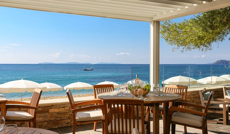 Terrace with chairs and tables over looking beach and sea at Pinede Plage