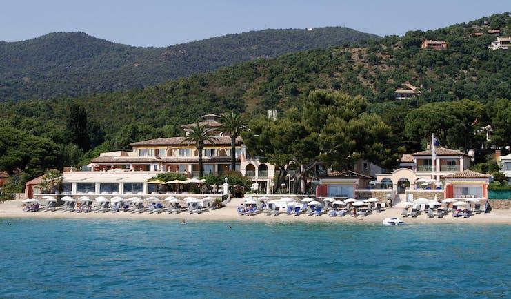 Le Club de Cavaliere Provence exterior beach view of beachside hotel sun loungers and sea