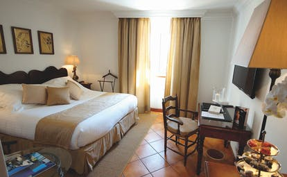 Standard double room with large double bed and old fashioned decor