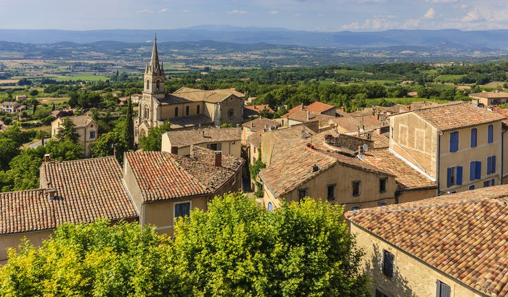 View of the houses of the Luberon village of Bonnieux with tiled roofs