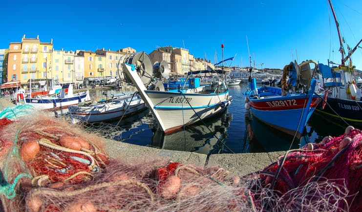 Fishing boats and nets on harbour side in St Trpoez