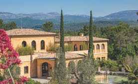 Terre Blanche Hotel and Spa Provence exterior large yellow building with arched windows and archways