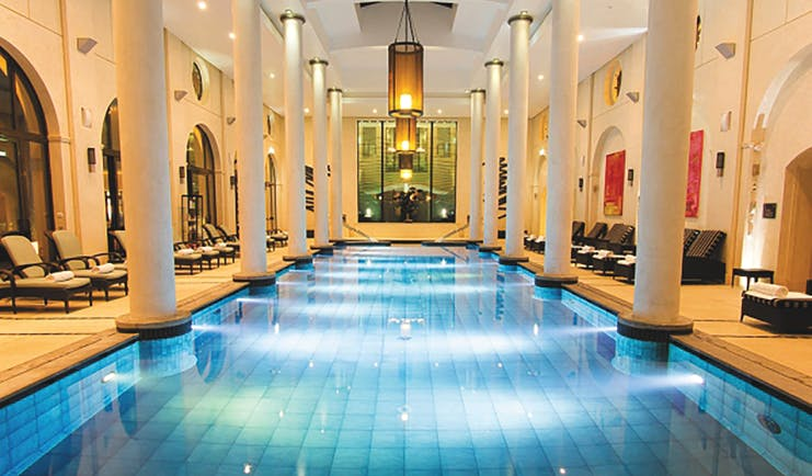 Terre Blanche Hotel and Spa Provence indoor spa pool with wooden loungers and round columns