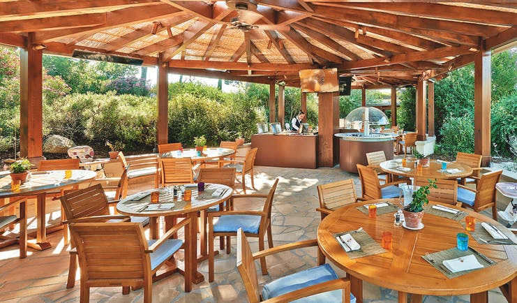 Terre Blanche Hotel and Spa Provence kids restaurant dining pagoda dining area with several tables and a high chair