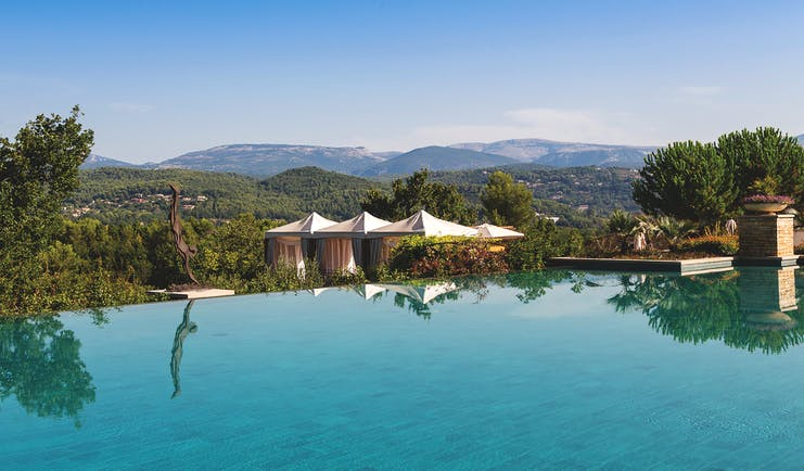 Terre Blanche Hotel and Spa Provence outdoor pool overlooking cabanas