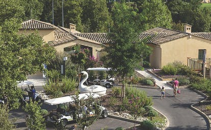 Terre Blanche Hotel and Spa Provence outdoor villa buildings and golf buggy