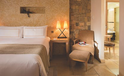 Terre Blanche Hotel and Spa Provence prestige bedroom with yellow walls two bedside tables and lamps