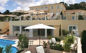 Althoff Villa Belrose Saint Tropez exterior yellow building with balconies and outdoor pool