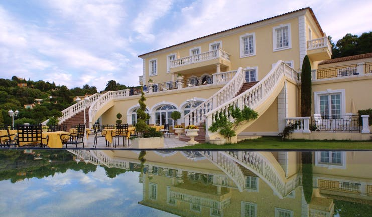Althoff Villa Belrose Saint Tropez outdoor terrace yellow building balcony and stair cases and pool
