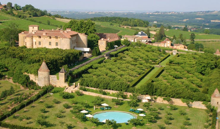 Chateau de Bagnols Rhone Valley aerial countryside view of castle with gardens and swimming pool
