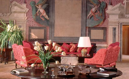 Chateau de Bagnols Rhone Valley lounge with frescos of cherubs and floral arrangements