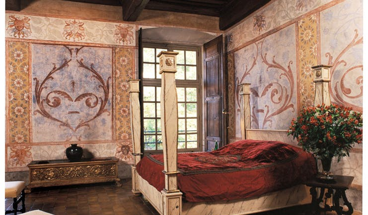 Chateau de Bagnols Rhone Valley suite chateau bedroom with frescos and four poster bed