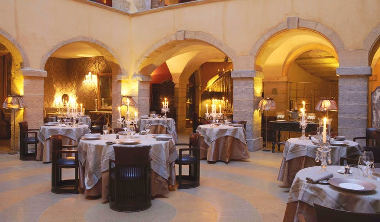 Hotel Cour des Loges Lyon restaurant dining room with candelabras and archways