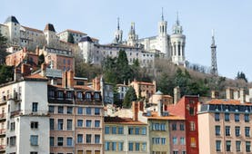 Lyon city centre with church and city buildings on a hillside