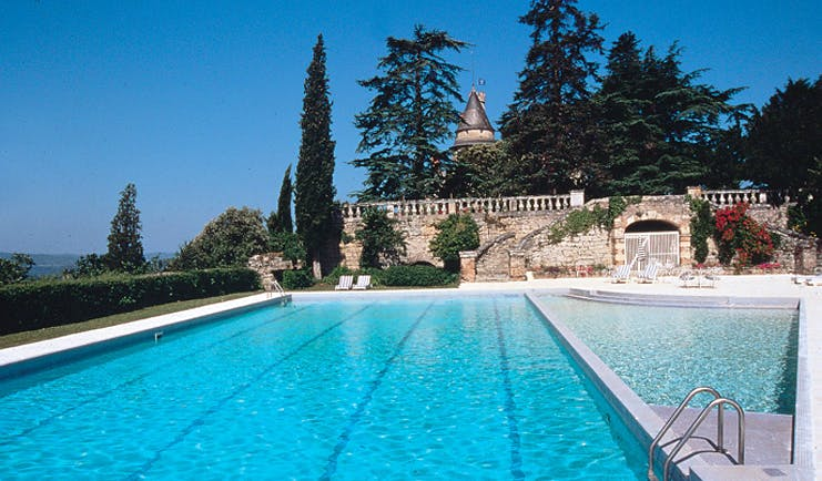 Chateau de Mercues Tarn and Lot outdoor pool with view of castle