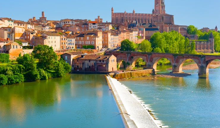 river tarn and bridge in town of albi