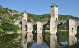 Medieval bridge with arches and turrets over river Lot at Cahors