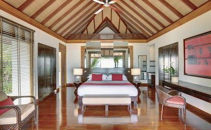 Amilla Fushi beach villa, douvked bed, modern comfortable decor, ceiling fan