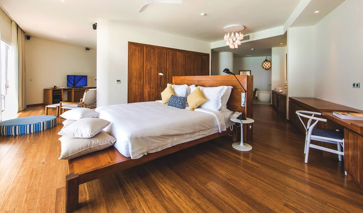 Amilla Fushi lagoon house interior, bed, bathroom, lounge area, fresh modern decor