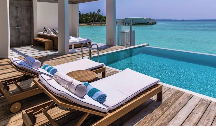 Amilla Fushi lagoon house private pool, sun loungers, views over the sea