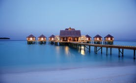 Anantara Kihavah Maldives jetty across the water villas sea