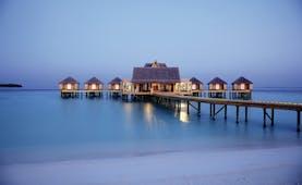 Anantara Kihavah Maldives jetty across the water villas sea