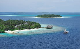 Bandos Maldives islands shot vegetation villas boat on water