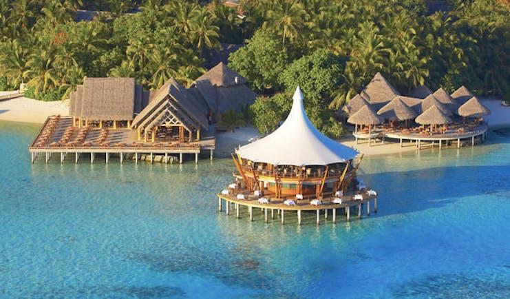 Baros Spa Maldives restaurant surrounded by sea