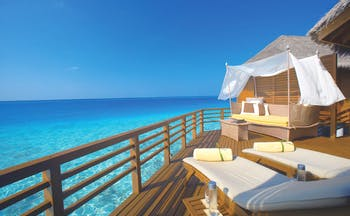 Baros Spa Maldives water villa terrace sun loungers sofa overlooking sea