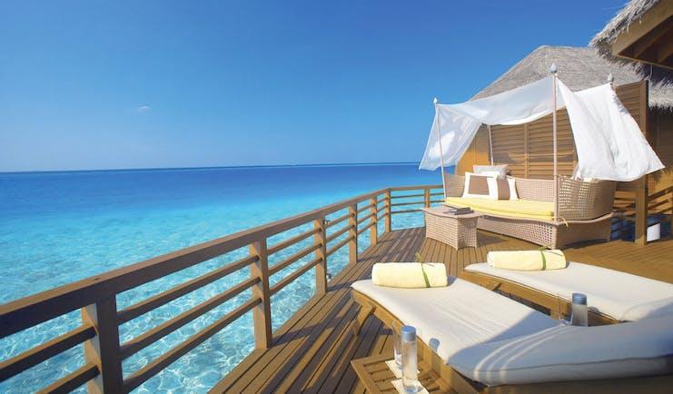 Baros Spa Maldives water villa terrace sun loungers sofa overlooking sea