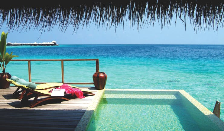 Coco Bodu Hithi escape villa private pool and terrace, views out over the sea