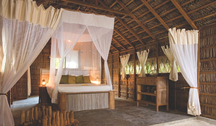 Coco Palm Dhuni Kolhu Maldives bedroom canopied bed wicker walls