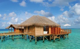 Conrad Maldives deluxe water villa exterior private terrace in the sea
