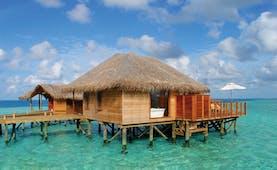 Conrad Maldives deluxe water villa exterior private terrace in the sea