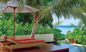 Constance Halaveli Maldives beach villa infinity pool sun lounger path to beach