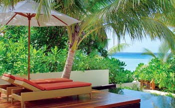 Constance Halaveli Maldives beach villa infinity pool sun lounger path to beach