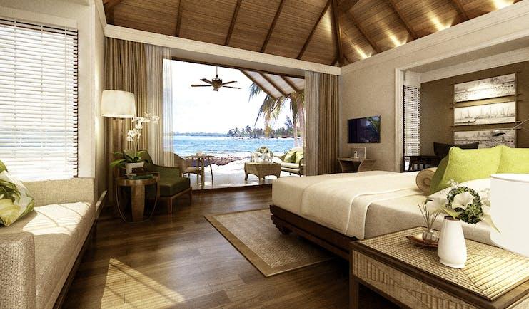 Dusit Thani Maldives beach villa bed sofa private terrace modern décor