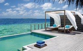 Dusit Thani Maldives ocean villa terrace infinity pool sun lounger over looking ocean