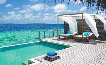 Dusit Thani Maldives ocean villa terrace infinity pool sun lounger over looking ocean