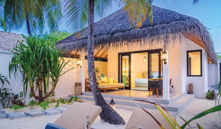 Finolhu beach villa, outside space with sun loungers, leading directly on to beach