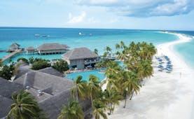 Finolhu aerial shot of resort, beach plam trees, hotel buildings