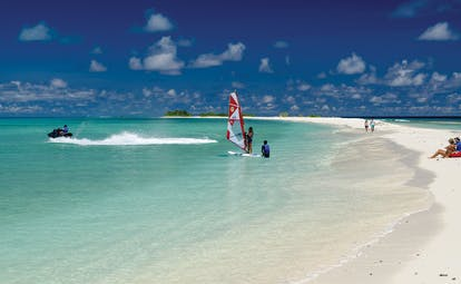 Finolhu watersports on the beach, people playing with hobie cats