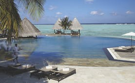 Four Seasons Kuda Huraa Maldives pool infinity pool overlooking sea