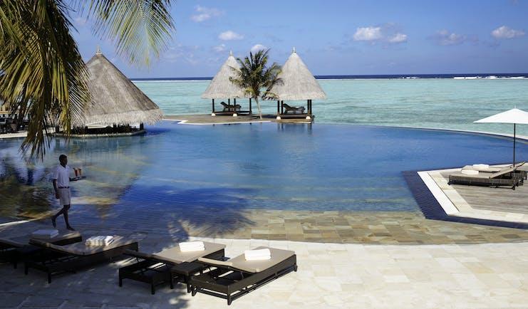 Four Seasons Kuda Huraa Maldives pool infinity pool overlooking sea