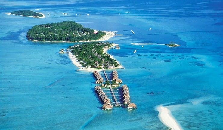 Four Seasons Kuda Huraa Maldives resort aerial shot island villas over sea